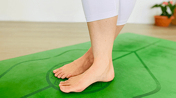 Cross feet and align your toes